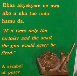 [ Ekaa akyekyere ne nwa nko a nka tuo nnto hamu da.  'If it were only the tortoise and the snail, the gun would never be fired.' A symbol of peace ]